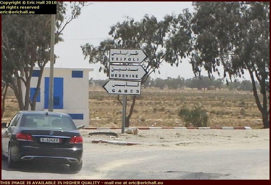 signpost tripoli libya libyan border