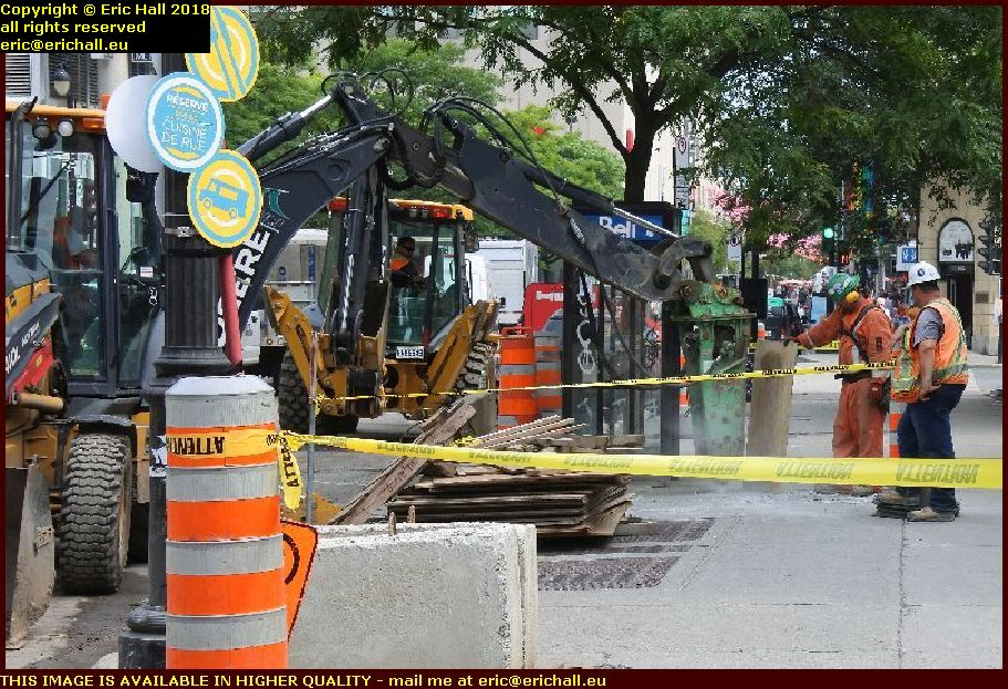 black men working rue st catherine est montreal canada august aout 2018