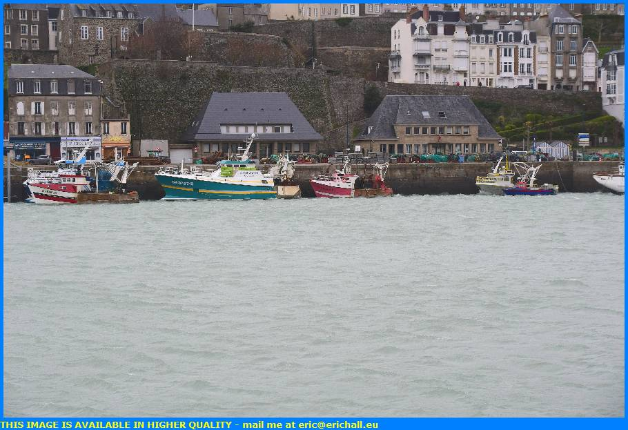 trawler fishing boat waves port de granville harbour manche normandy france eric hall