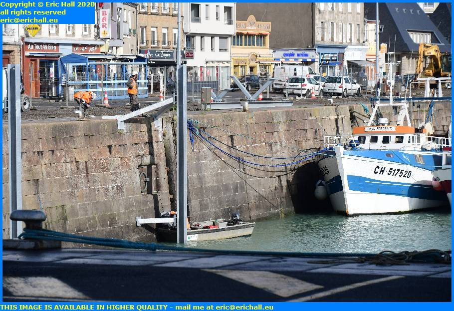 erecting pontoon supports rue du port de granville  harbour manche normandy france eric hall