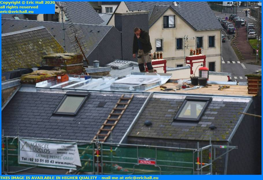 repairing roof rue des juifs granville manche normandy france eric hall