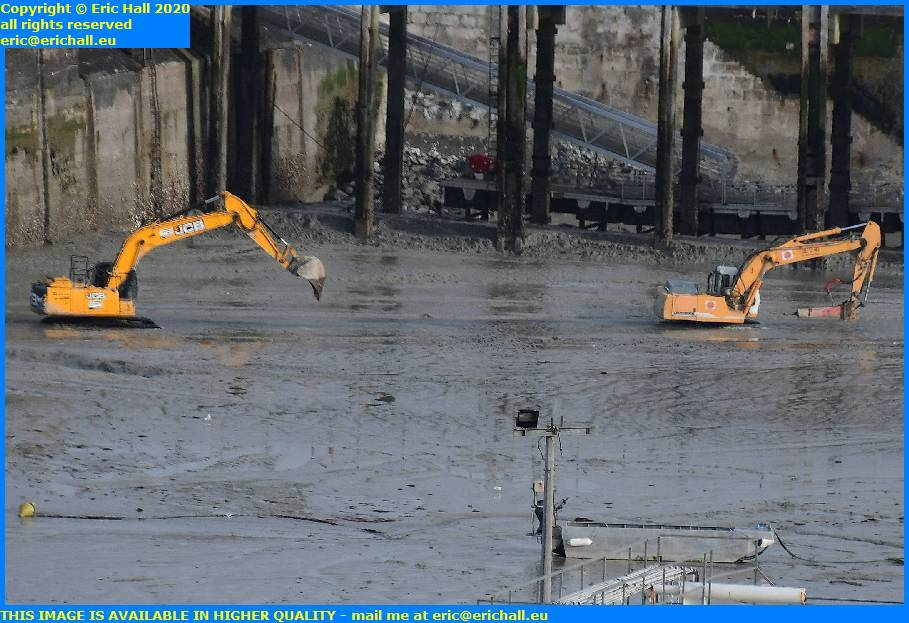 digger hydraulic drill concrete breaker port de granville harbour manche normandy france eric hall
