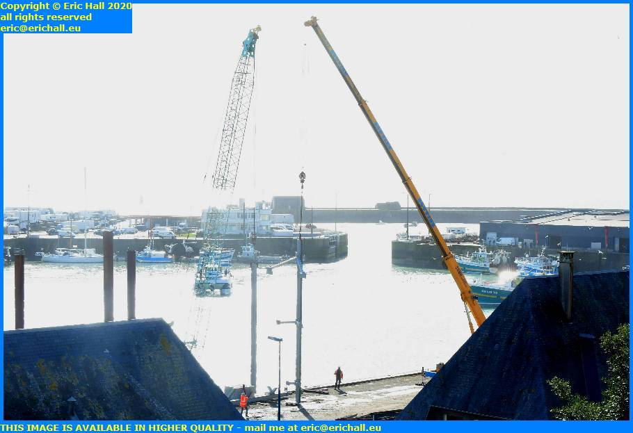 cranes slinging into place pontoon support rue du port de granville harbour manche normandy france eric hall
