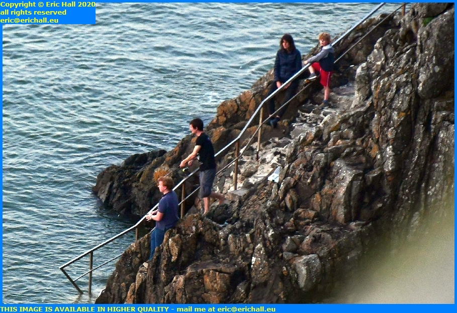 fishing from the steps rue du port granville manche normandy france eric hall
