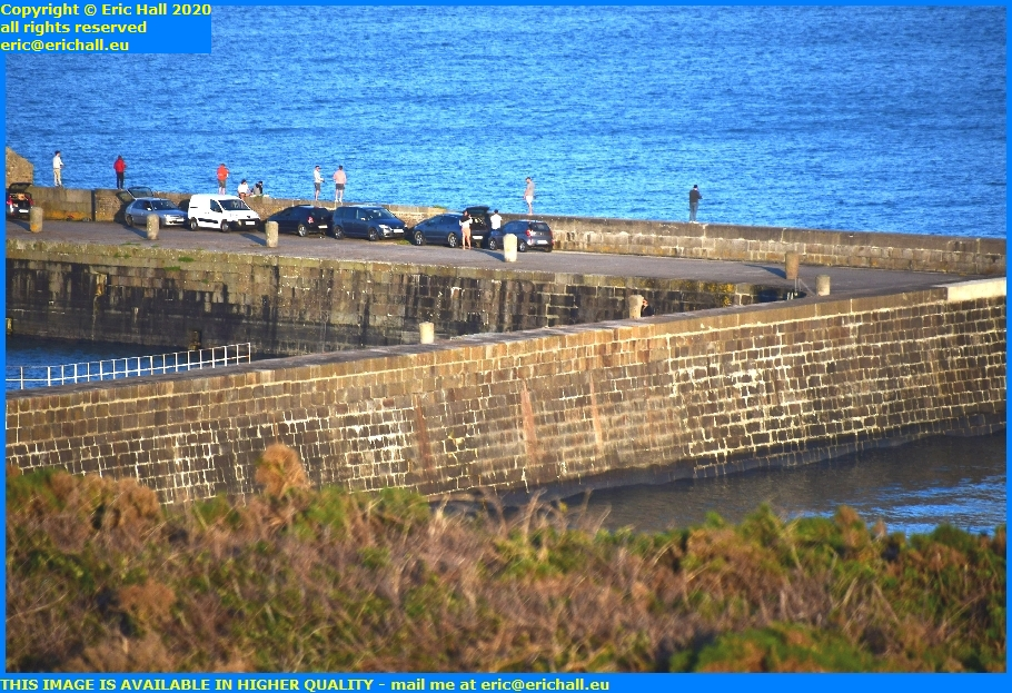 people fishing from wall port de granville harbour manche normandy france eric hall