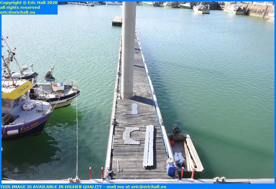 installing edging floating pontoon rue de port de granville harbour manche normandy france eric hall