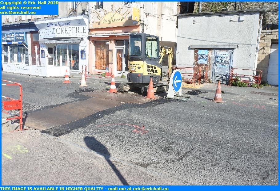 digging trench rue du port de granville harbour manche normandy france eric hall