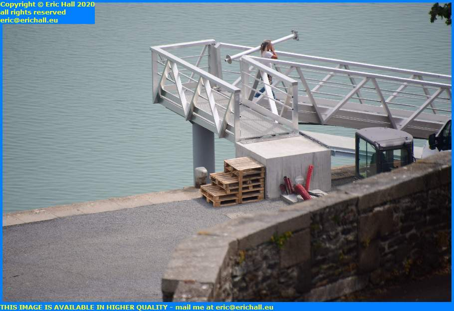 wooden steps onto ramp down to fishing boats rue du port de granville harbour manche normandy france eric hall