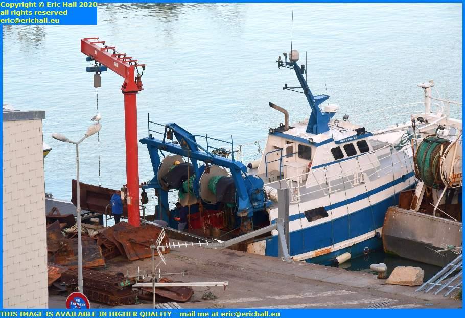 loading dredges into trawler rue du port de granville harbour manche normandy france eric hall