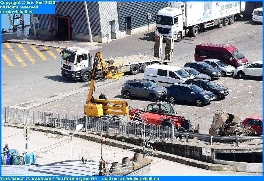 heavy equipùent being unloaded rue du port de granville harbour manche normandy france eric hall