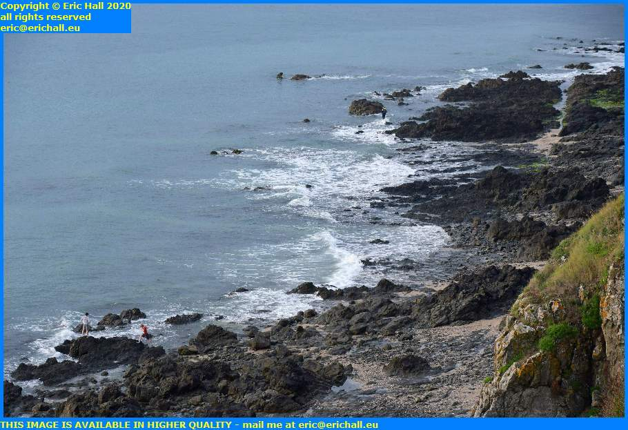 kids playing on the rocks beach plat gousset granville manche normandy france eric hall