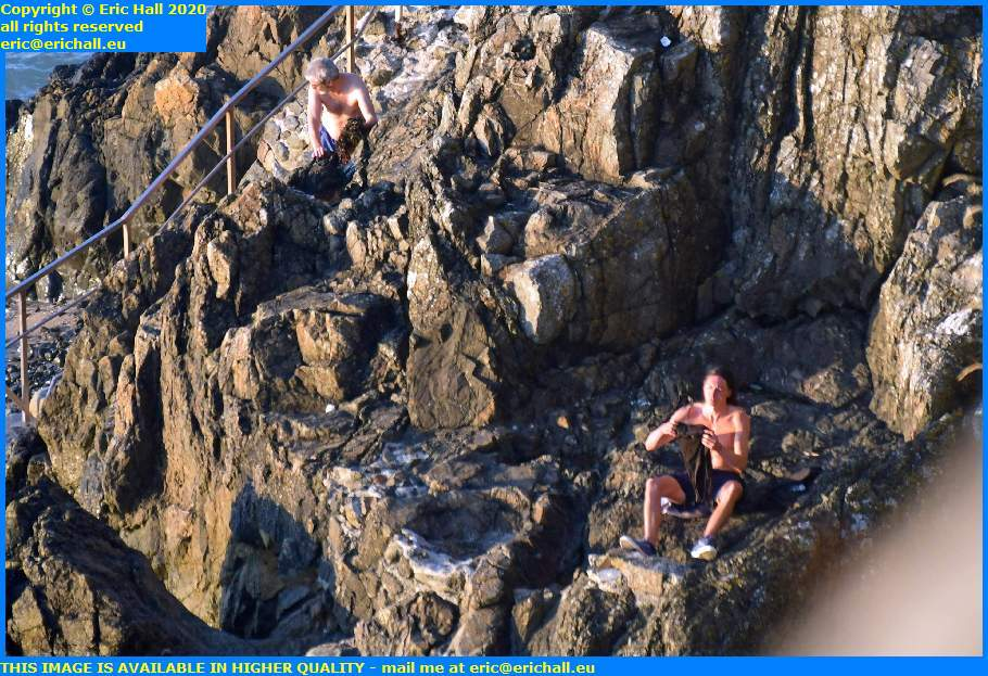 people sitting on rock plat gousset granville manche normandy france eric hall