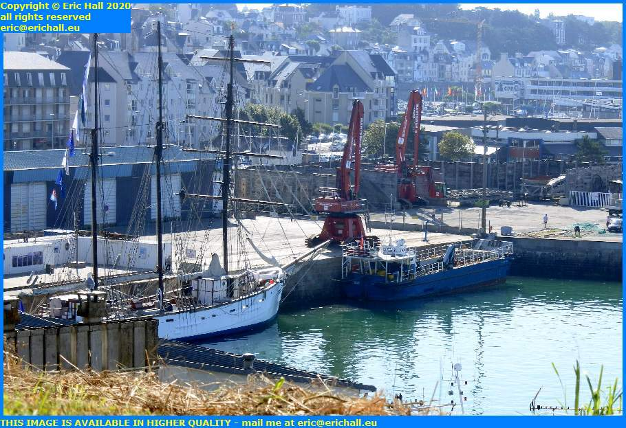 marite normandy trader men with fishing net port de granville harbour manche normandy france eric hall
