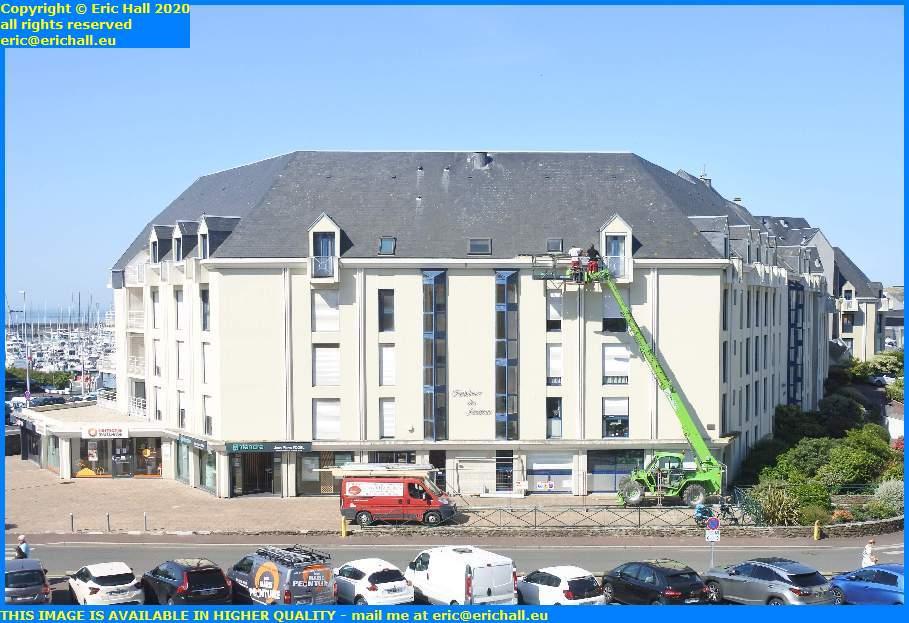 fixing roof on building Rue de la Fontaine Bedeau granville manche normandy france eric hall