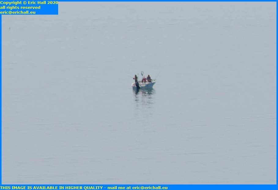 men fishing in boat english channel granville manche normandy france eric hall