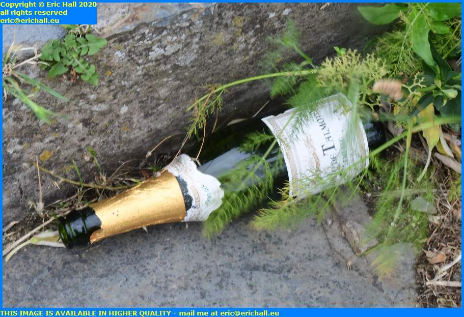 bottle of champagne discarded place du parvis notre dame granville manche normandy france eric hall