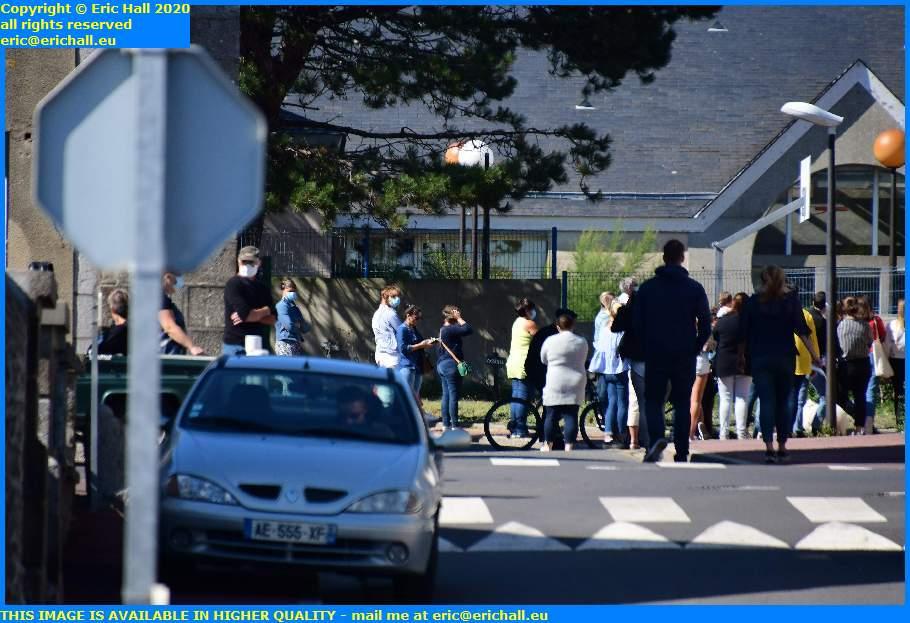 crowds outside school bad parking boulevard vaufleury granville manche normandy france eric hall