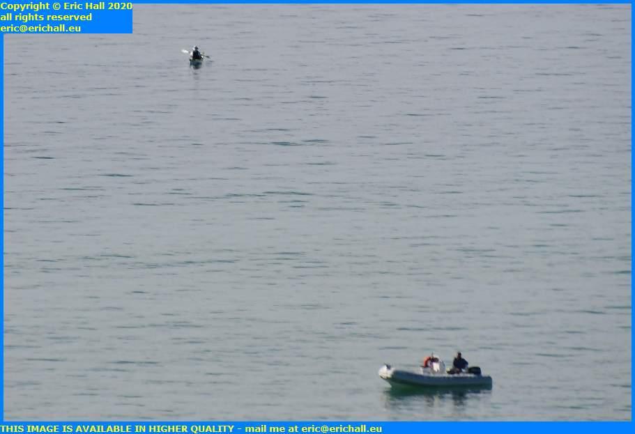 fishermen in zodiac kayak english channel granville manche normandy france eric hall