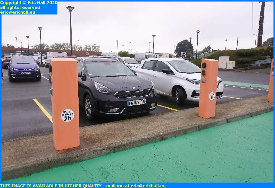 cars parking at electric charging bay leclerc granville manche normandy france eric hall