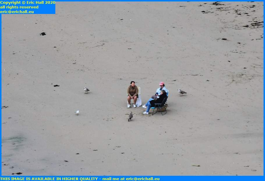 people sitting on beach plat gousset granville manche normandy france eric hall