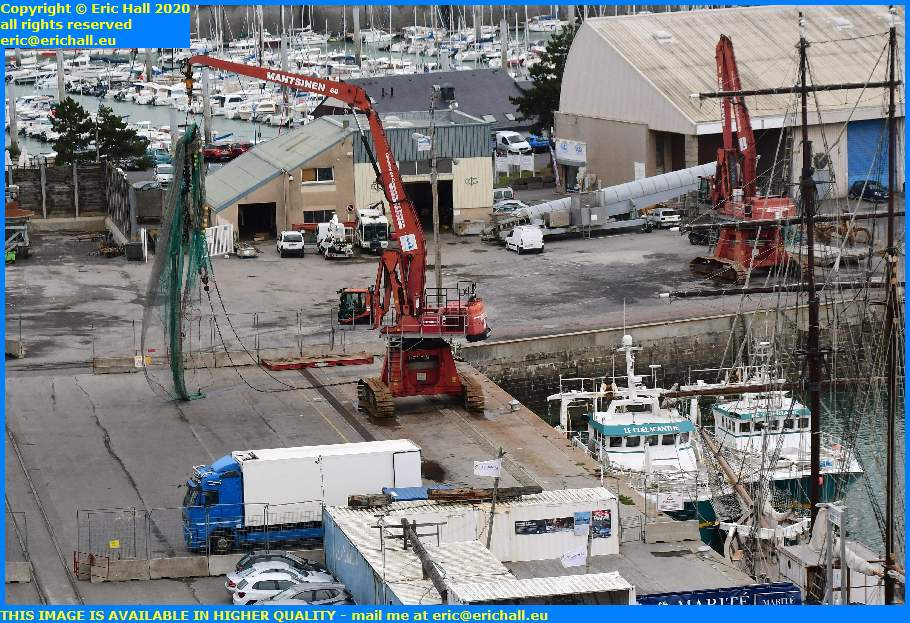 crane removing fishing nets coelacanthe tiberiade trawler port de granville harbour manche normandy france eric hall