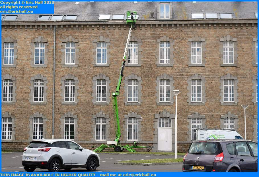 Repairing Roof Guttering College Malraux Place d'Armes Granville Manche Normandy France Eric Hall