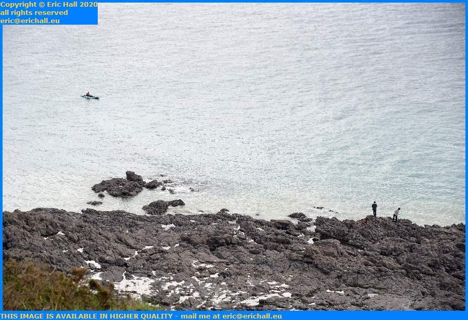 Man in Kayak Fishing From Rocks Pointe du Roc Granville Manche Normandy France Eric Hall