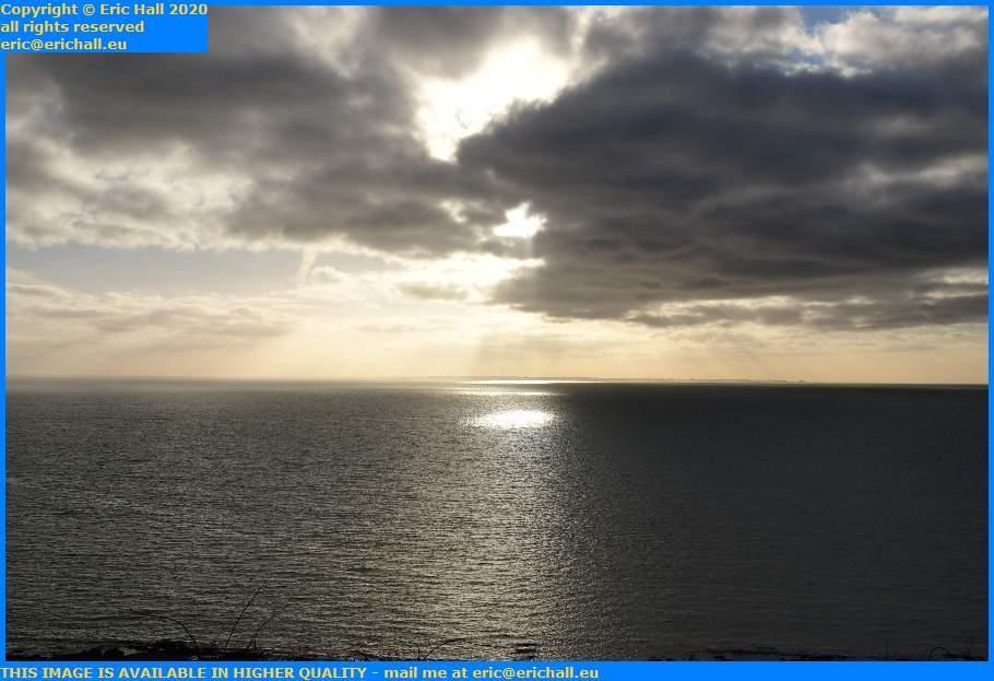 sun shining through clouds baie de mont st michel Granville Manche Normandy France Eric Hall