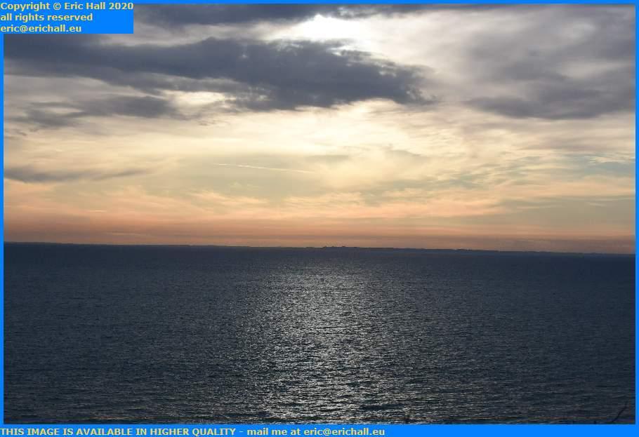 sun reflecting off sea baie de mont st michel brittany coast Granville Manche Normandy France Eric Hall
