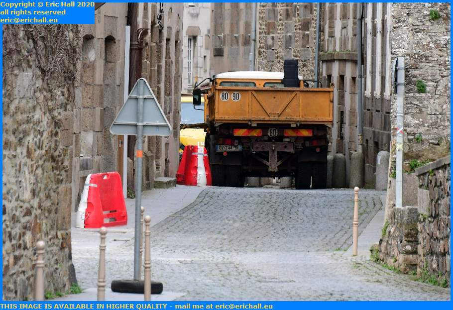 replacing paving slabs rue st jean Granville Manche Normandy France Eric Hall