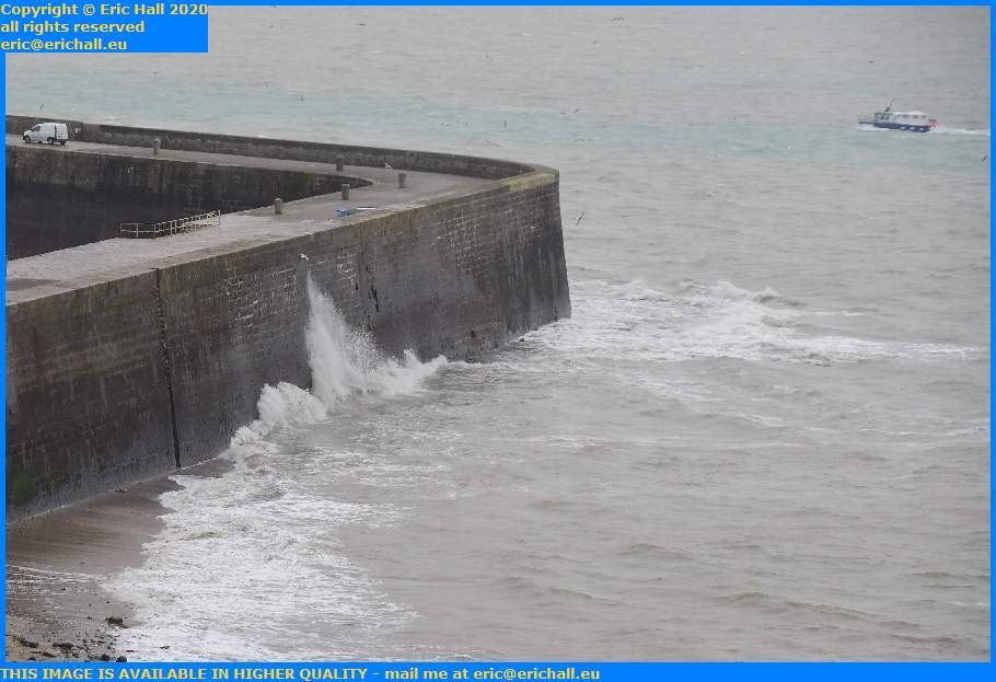 waves on sea wall port de Granville harbour Manche Normandy France Eric Hall