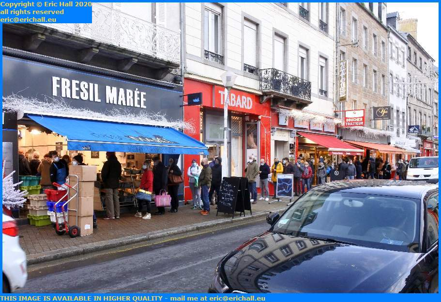 crowds at seafood shop rue lecampion Granville Manche Normandy France Eric Hall