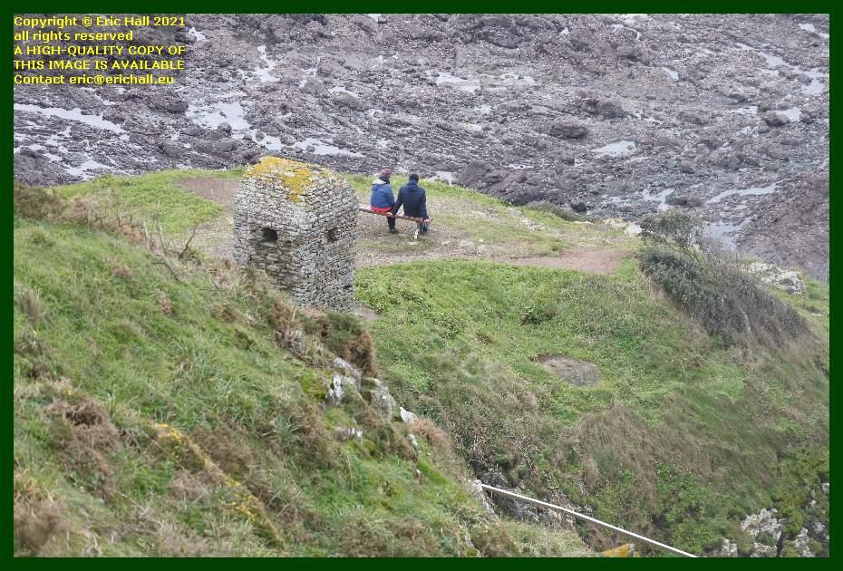 people sitting by cabanon de guet pointe du roc Granville Manche Normandy France Eric Hall