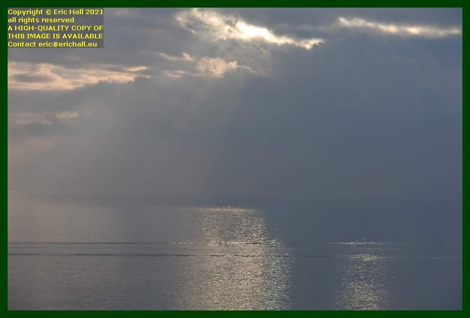 beautiful sun shining on sea baie de mont st michel Granville Manche Normandy France Eric Hall