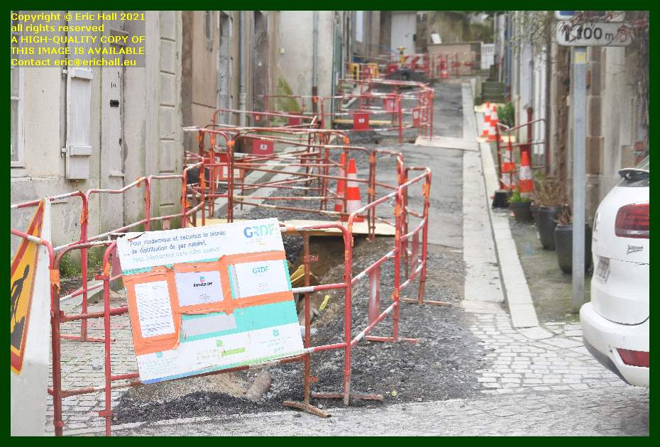 relaying gas pipes rue st michel Granville Manche Normandy France Eric Hall