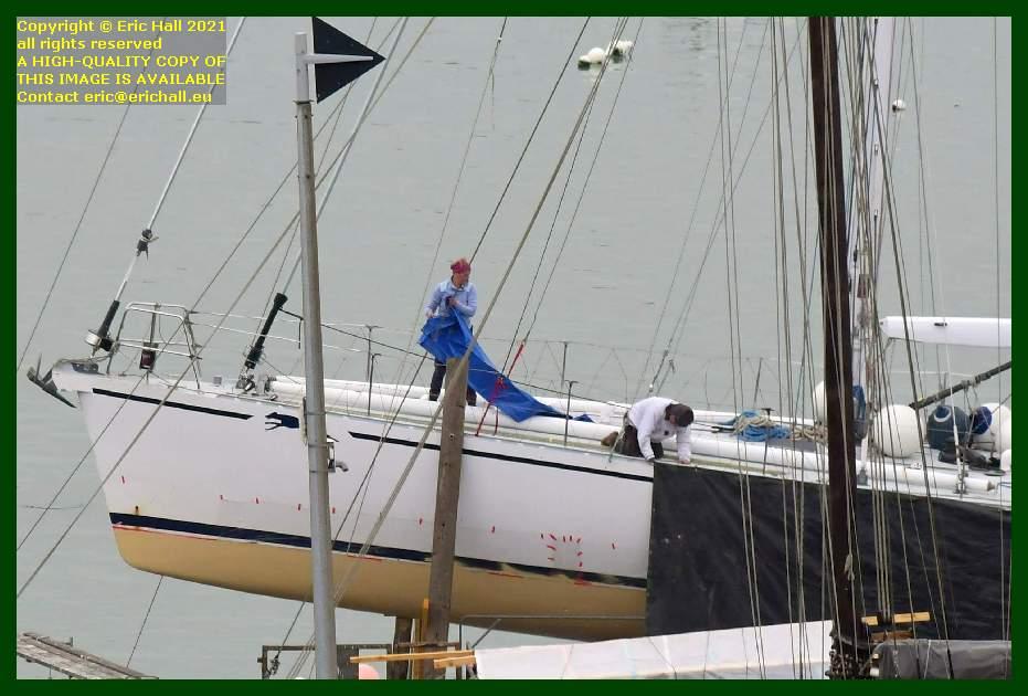 people working on yacht chantier navale port de Granville harbour Manche Normandy France Eric Hall