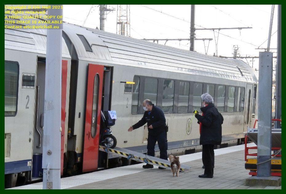 unloading disabled passenger from train gare de leuven railway station belgium Eric Hall