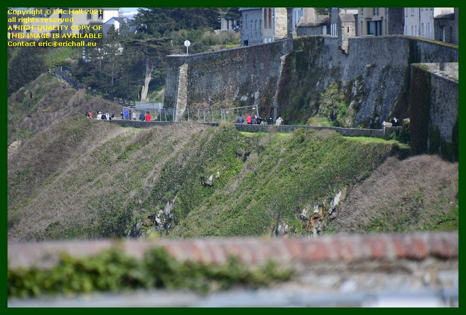 people taking footpath under city walls rue du nord Granville Manche Normandy France Eric Hall