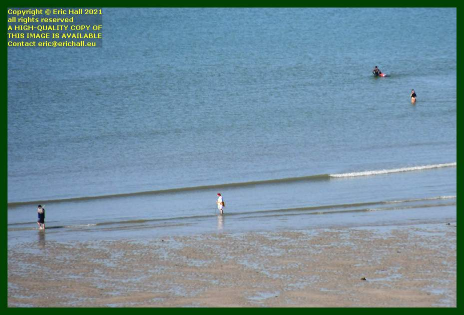 people swimming in water beach place d'armes Granville Manche Normandy France Eric Hall