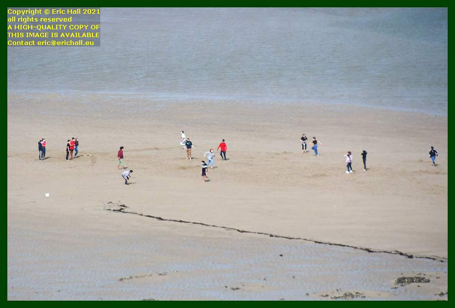 kids playing games on beach rue du nord Granville Manche Normandy France Eric Hall