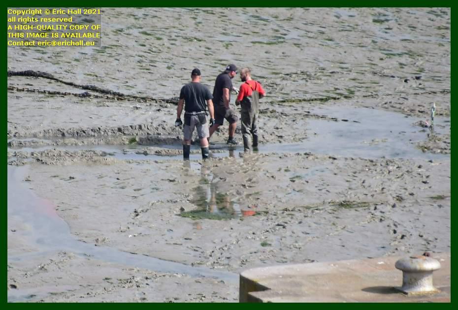men working in port de Granville harbour Manche Normandy France Eric Hall
