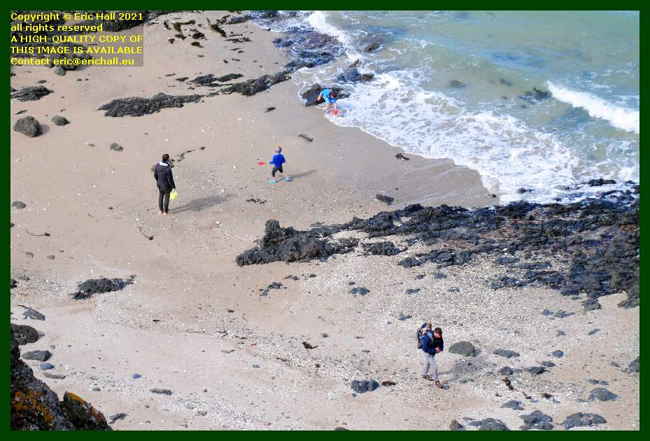 people on beach place d'armes Granville Manche Normandy France Eric Hall