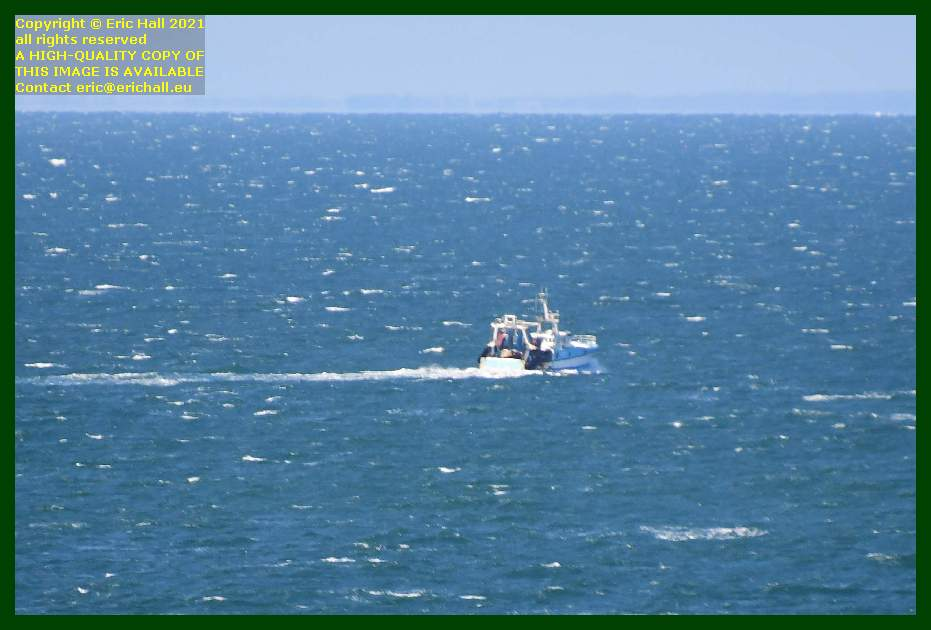 trawler heading out to sea english channel Granville Manche Normandy France Eric Hall