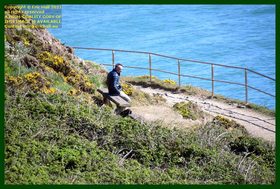 man sitting on bench pointe du roc Granville Manche Normandy France Eric Hall