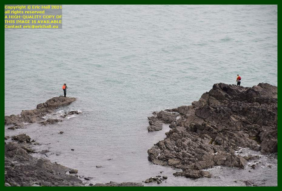 men fishing from rocks pointe du roc Granville Manche Normandy France Eric Hall