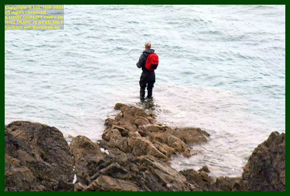 man fishing from rocks pointe du roc Granville Manche Normandy France Eric Hall