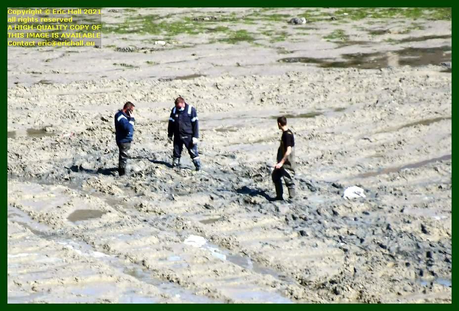 men inspecting harbour bed port de Granville harbour Manche Normandy France Eric Hall