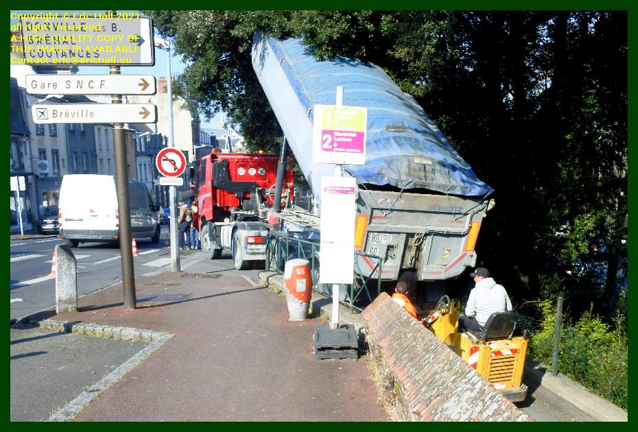 emptying tarmacadam for road surface rue du rocher Granville Manche Normandy France Eric Hall