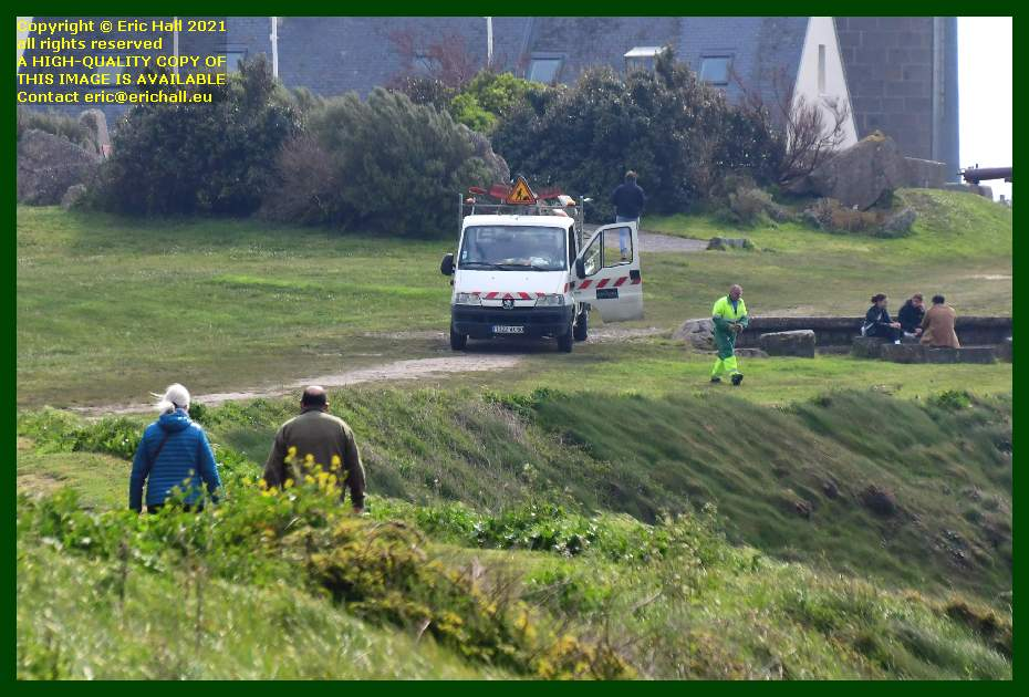council worker working on lawn pointe du roc Granville Manche Normandy France Eric Hall