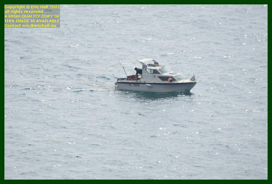 fisherman in cabin cruiser pointe du roc baie de mont st michel Granville Manche Normandy France Eric Hall